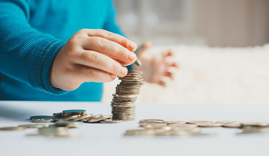 Age-by-age guide to teaching kids about money
